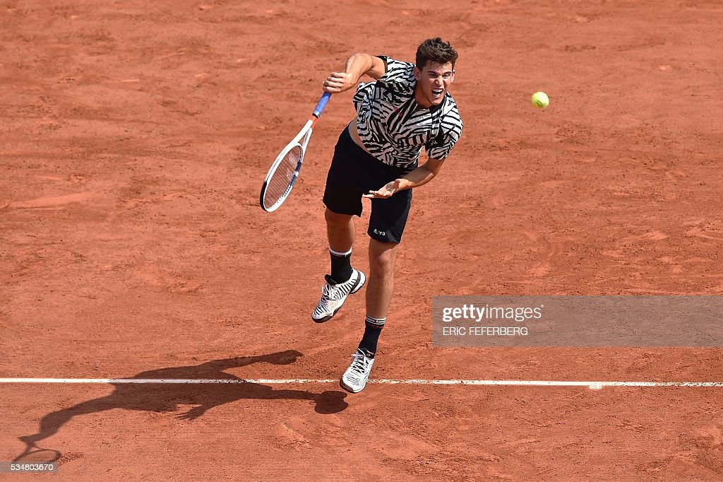 Austria's Dominic Thiem serves the ball to Germany's Alexander Zverev during their men's third round match at the Roland Garros 2016 French Tennis Open in Paris on May 28, 2016. / AFP / Eric FEFERBERG