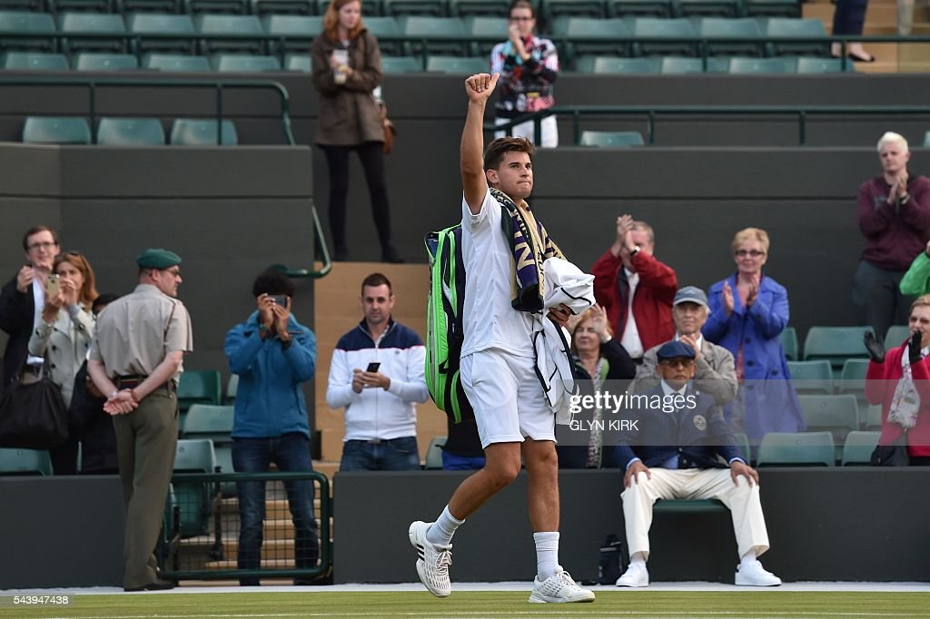 Austria's Dominic Thiem waves after losing to Czech Republic's Jiri Vesely during their men's singles second round match on the fourth day of the 2016 Wimbledon Championships at The All England Lawn Tennis Club in Wimbledon, southwest London, on June 30, 2016. / AFP / GLYN