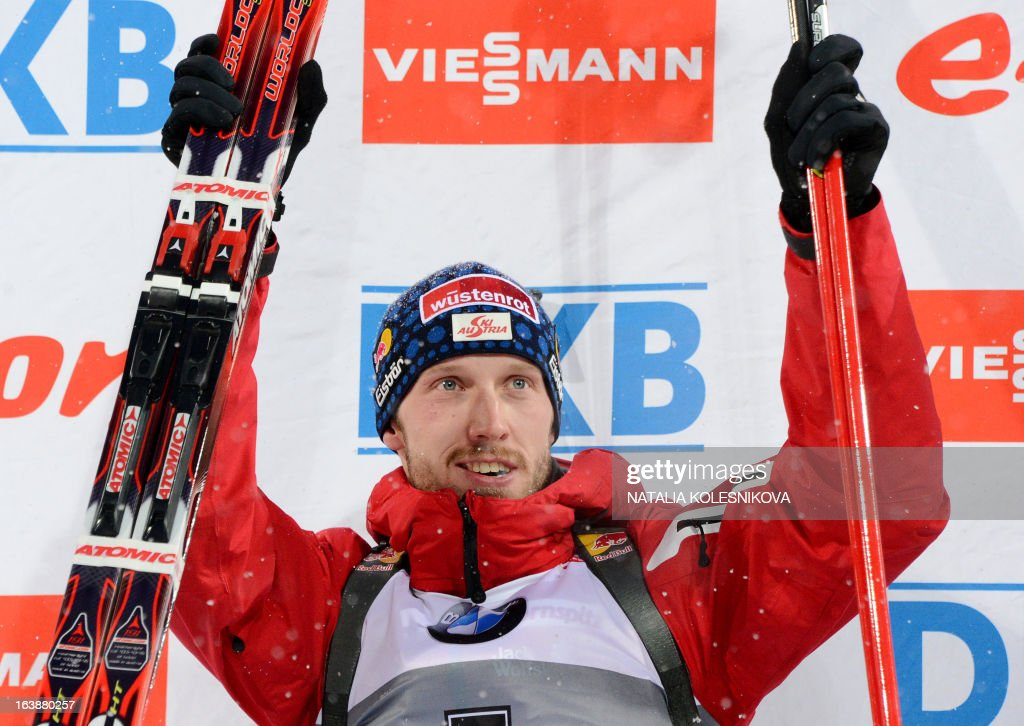 Austria's Dominik Landertinger celebrates on the podium after winning second place in the men's 15 km mass start event of the IBU Biathlon Word Cup in the Siberian city of Khanty-Mansiysk, on March 17, 2013. France's Martin Fourcade took the first place ahead of Austria's Dominik Landertinger and Norway's Emil Hegle Svendsen.