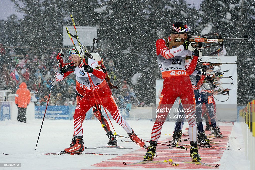 Austria's Dominik Landertinger (L) leaves the shooting range during the men's 15 km mass start event of the IBU Biathlon Word Cup in the Siberian city of Khanty-Mansiysk, on March 17, 2013. France's Martin Fourcade took first place ahead of Austria's Dominik Landertinger and Norway's Emil Hegle Svendsen.