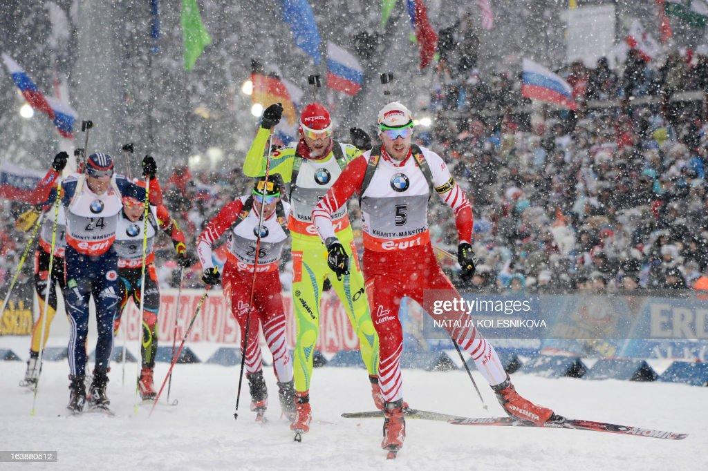 Austria's Dominik Landertinger (R) races to place second in the men's 15 km mass start event of the IBU Biathlon Word Cup in the Siberian city of Khanty-Mansiysk, on March 17, 2013. France's Martin Fourcade took first place ahead of Austria's Dominik Landertinger and Norway's Emil Hegle Svendsen.