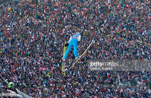TOPSHOT Austria's Elias Tollinger competes during the trial round of the Four Hills competition of the FIS Ski Jumping World Cup in Innsbruck on...
