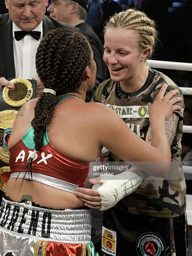 Austria's Eva Voraberger (R) congratulats Mexico's Esmeralda Moreno after Moreno won the WIBO Super Flyweight World Championship boxing fight in Vienna on April 30, 2016. / AFP / APA / HANS PUNZ / Austria OUT