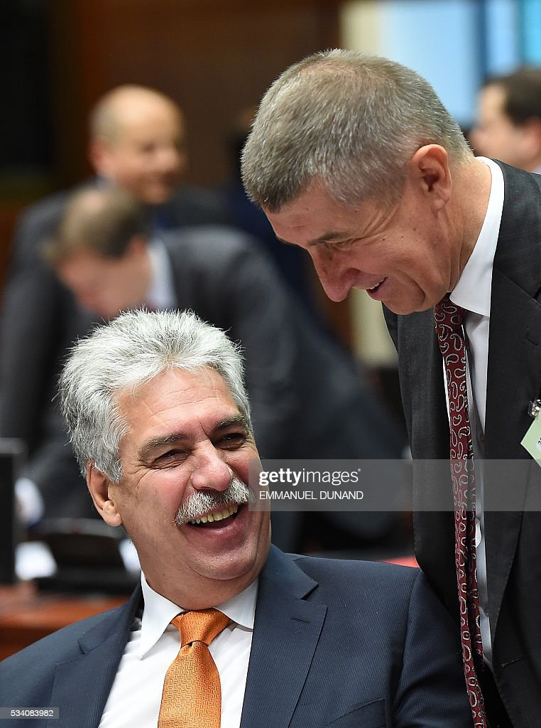 Austria's Finance Minister HansJoerg Schelling (L) and Czech Republic Finance Minister Andrej Babis attend an Economic and Financial (ECOFIN) Affairs Council meeting at the European Council, in Brussels, on May 25, 2016. / AFP / EMMANUEL