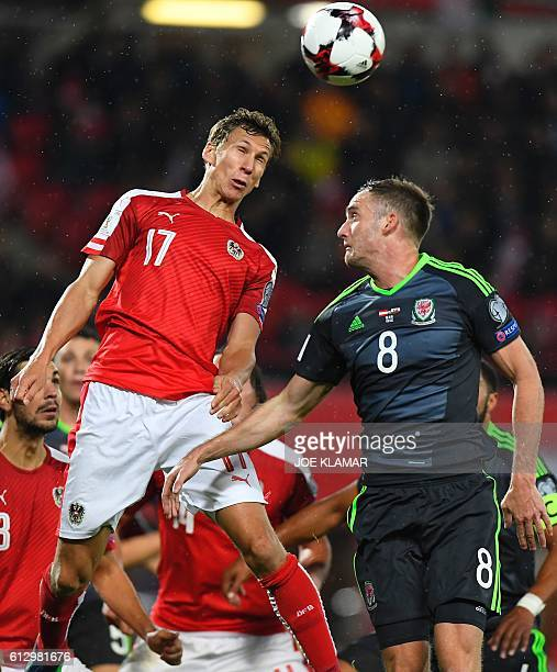 Austria's Florian Klein vies with Andy King of Wales during the WC 2018 football qualification match between Austria and Wales in Vienna on October 6...