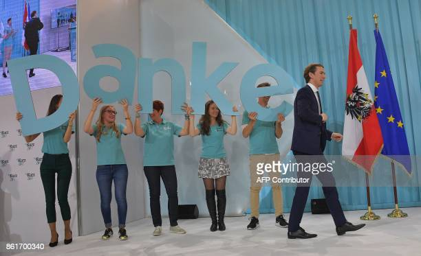 Austria's Foreign Minister and leader of Austria's centreright People's Party Sebastian Kurz arrives on stage to attend the party's election event...