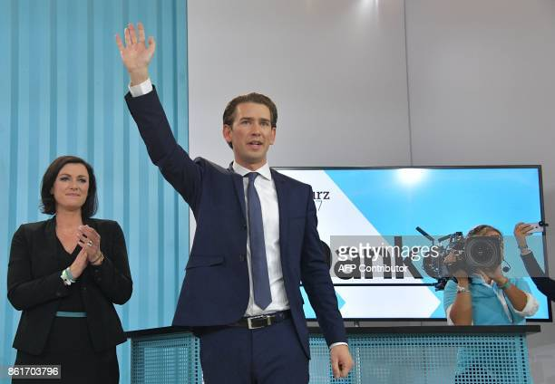 Austria's Foreign Minister and leader of Austria's centreright People's Party Sebastian Kurz waves to supporters during the party's election event...
