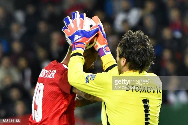 Austria's forward Guido Burgstaller vies with Serbia's goalkeeper Vladimir Stojkovic during the FIFA World Cup 2018 qualification football match...
