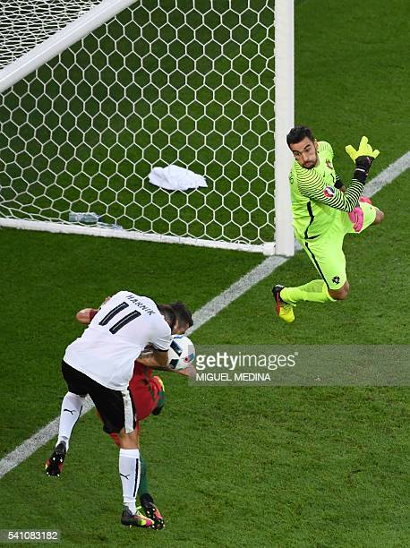 TOPSHOT Austria's forward Martin Harnik and Portugal's goalkeeper Rui Patricio vie for the ball during the Euro 2016 group F football match between...