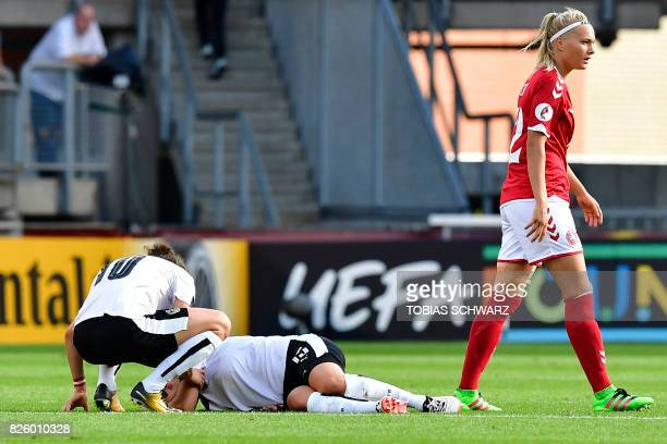 Austria's forward Nicole Billa lies on the pitch during the UEFA Womens Euro 2017 football tournament semifinal match between Denmark and Austria at...