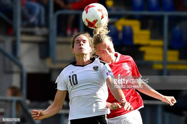 Austria's forward Nina Burger vies for the ball with Denmark's midfielder Maja Kildemoes during the UEFA Womens Euro 2017 football tournament...