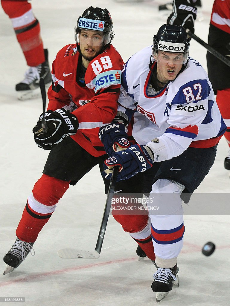 Austria's forward Raphael Herburger (L) vies with Slovakia's forward Tomas Kopecky during a preliminary round game Slovakia vs Austria of the IIHF International Ice Hockey World Championship in Helsinki on May 10, 2013.