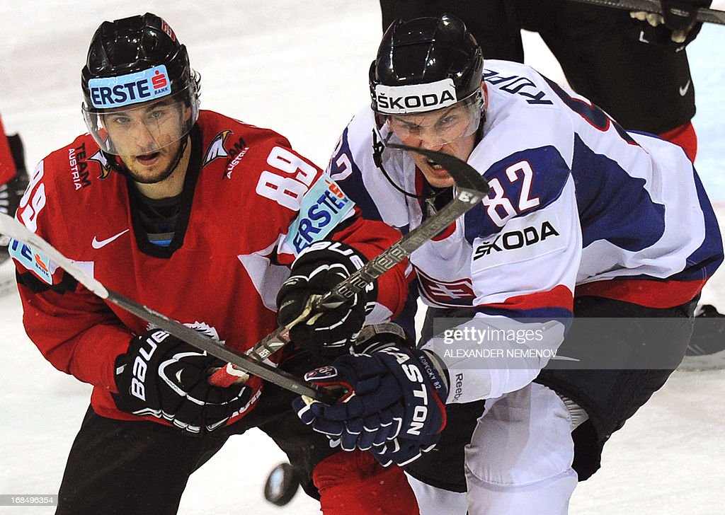 Austria's forward Raphael Herburger (L) vies with Slovakia's forward Tomas Kopecky during a preliminary round game Slovakia vs Austria of the IIHF International Ice Hockey World Championship in Helsinki on May 10, 2013. AFP PHOTO / ALEXANDER NEMENOV RESTRICTED TO EDITORIAL USE