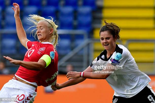 Austria's forward Sarah Zadrazil pulls the jersey of Denmark's forward Pernille Harder during the UEFA Womens Euro 2017 football tournament semifinal...
