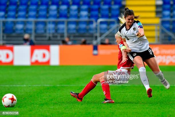 Austria's forward Sarah Zadrazil vies for the ball with Denmark's forward Pernille Harder during the UEFA Womens Euro 2017 football tournament...
