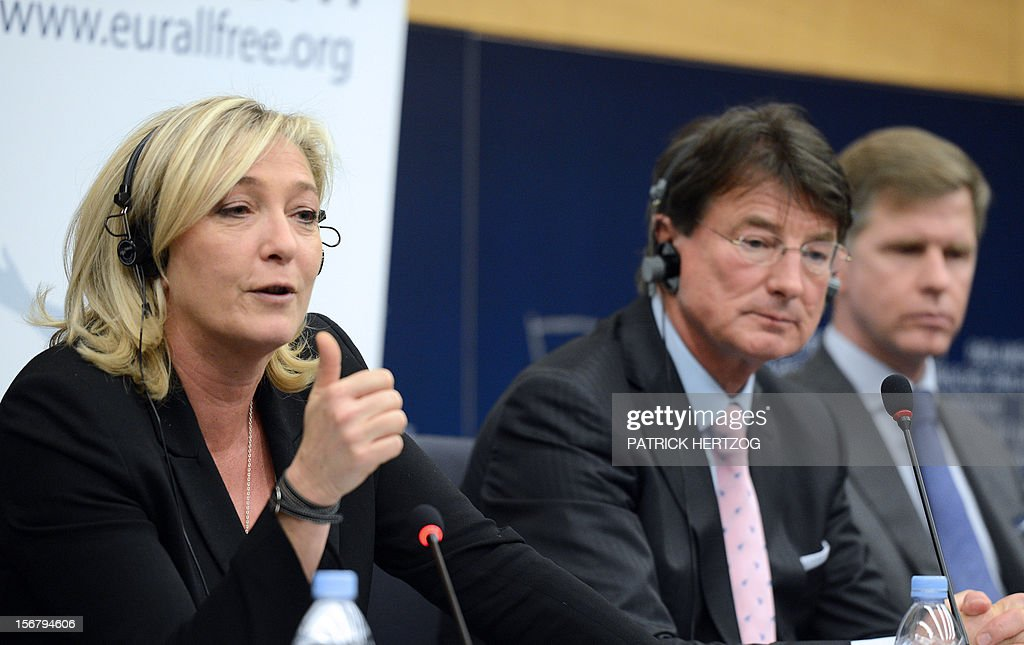 Austria's Franz Obermayr (C), member of Austrian Freedom Party, France's Marine Le Pen (L), President of French far-right party Front National (FN) and Belgium's Philip Claeys, member of Vlaams Belang party, give a joint press conference about the European Alliance for Freedom (EAF), a pan-European alliance of MEPs and MPs from national and regional parliaments, during a plenary session of the European parliament, in Strasbourg, eastern France, on November 21, 2012. AFP PHOTO / PATRICK HERTZOG
