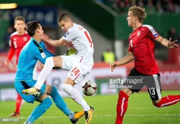 Austria's goalkeeper Heinz Lindner vies with Serbia's Mijat Gacinovic during the FIFA World Cup 2018 qualification football match between Austria and...