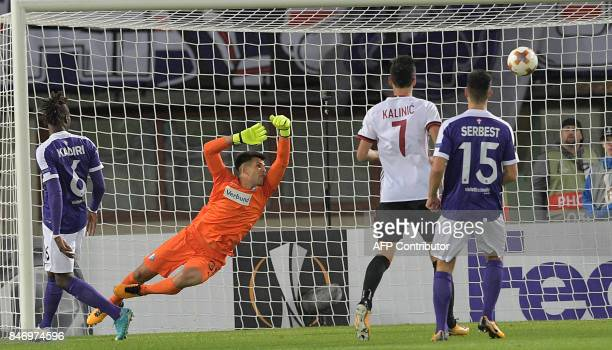 Austria's goalkeeper Osman Hadzikic fails to save as Milan's Turkish midfielder Hakan Calhanoglu scores to 10 during the group D UEFA Europa League...