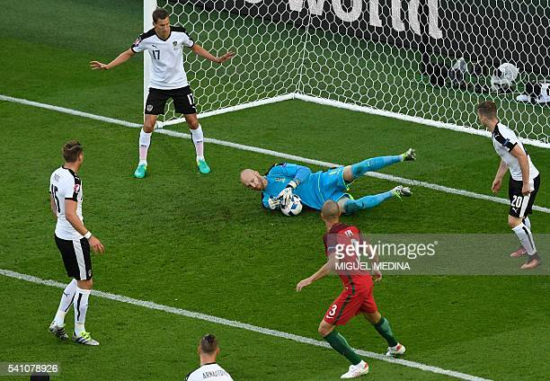 TOPSHOT Austria's goalkeeper Robert Almer saves a ball during the Euro 2016 group F football match between Portugal and Austria at the Parc des...