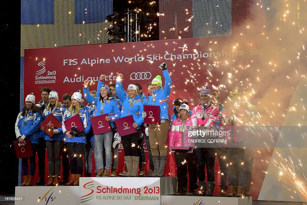 Austria's gold medalist team (C) poses next to Sweden's silver medalist team (L) and Germany's bronze medalist team during the medals ceremony at the end of the Nations Team event of the 2013 Ski World Championships in Schladming on February 13, 2013. AFP PHOTO / FABRICE COFFRINI