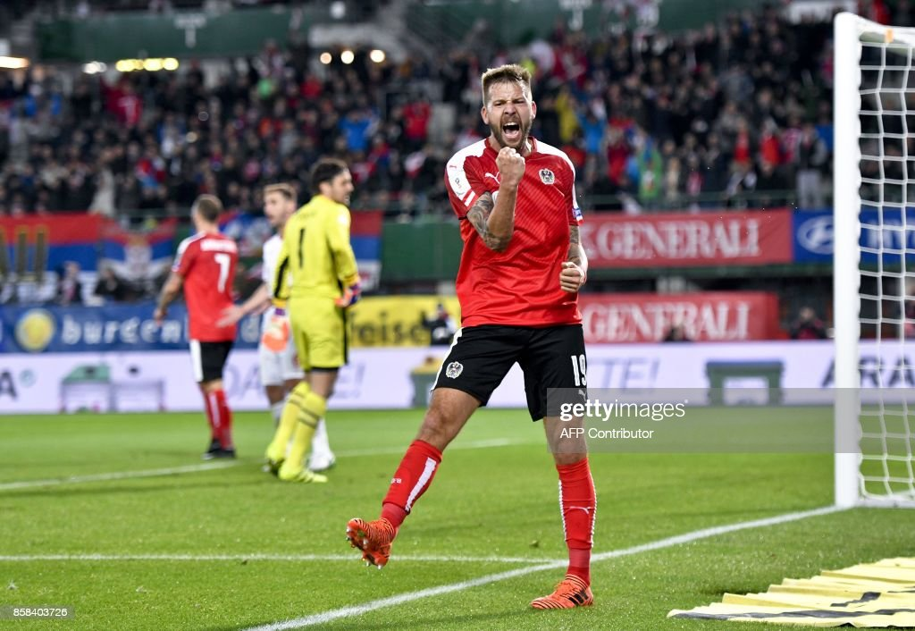 Austria's Guido Burgstaller celebrates after scoring a goal during he FIFA World Cup 2018 qualification football match between Austria and Serbia at the Ernst Happel stadium in Vienna on October 6, 2017. / AFP PHOTO / APA / HERBERT NEUBAUER / Austria OUT
