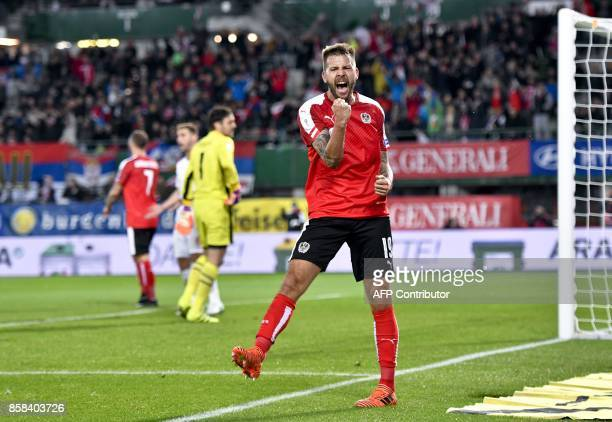Austria's Guido Burgstaller celebrates after scoring a goal during he FIFA World Cup 2018 qualification football match between Austria and Serbia at...