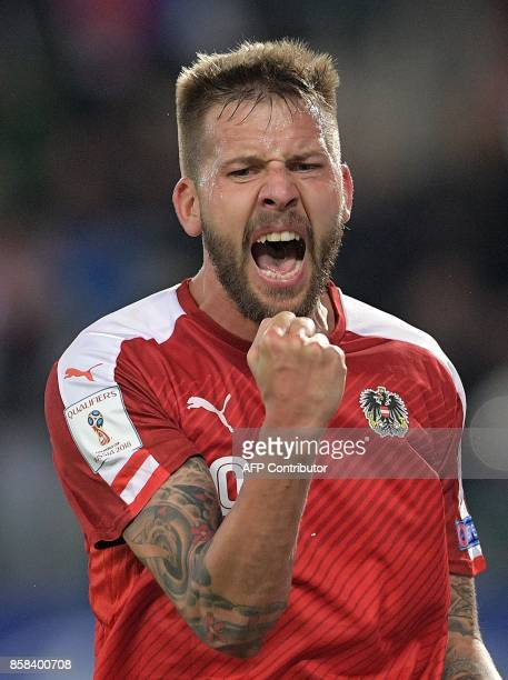 Austria's Guido Burgstaller celebrates after scoring a goal during the FIFA World Cup 2018 qualification football match between Austria and Serbia at...