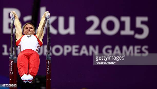 Austria's gymnast Matthias Schwab competes during the Men's Artistic Gymnastics Team and All Around qualification on day three of the Baku 2015...