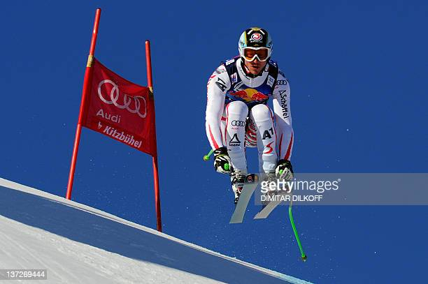 Austria's Hannes Reichelt competes during the second official training of the Men's downhill run on the Streif course in Kitzbuehel on January 18...