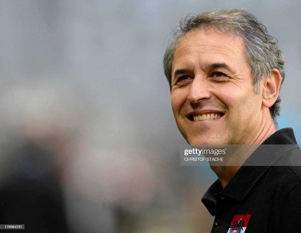 Austria's headcoach Marcel Koller laughs ahead of the final training's session of the Austria's national football team in the arena in Munich, southern Germany, on September 5, 2013 on the eve of the FIFA 2014 World Cup group C qualifying football match Germany vs Austria.