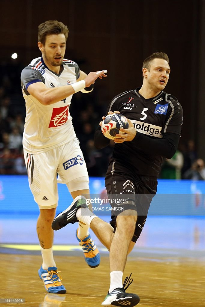 Austria's Hermann Maximillian (R) fights for the ball with France's <a gi-track='captionPersonalityLinkClicked' href=/galleries/search?phrase=Xavier+Barachet&family=editorial&specificpeople=4312948 ng-click='$event.stopPropagation()'>Xavier Barachet</a> (L) on January 12, 2015 during a friendly handball match France vs. Austria in the southern Paris suborb of Creteil in preparation for the World Handball championships.