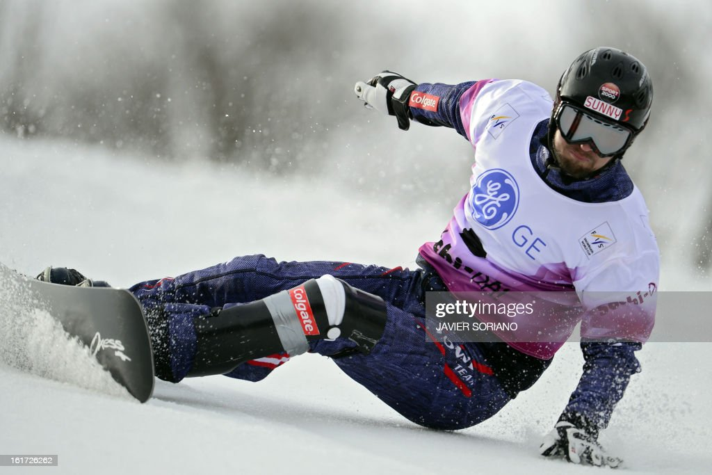 Austria's Ingemar Walder competes in a Snowboard Men Parallel Giant Slalom final race during the Snowboarding and Free Style World Cup Test Event at the Snowboard and Free Style Centre in Rosa Khutor near the Russian Black Sea resort of Sochi on February 14, 2013. AustrianAndreas Prommegger won the race ahead of Austrian Ingemar Walder and Slovenian Rok Flander.