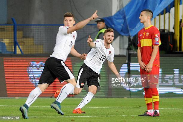 Austria's Jakob Jantscher and Marcel Sabitzer celebrate a goal during the Euro 2016 qualifying football match between Montenegro and Austria at the...