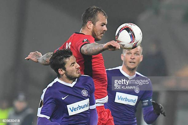 FK Austria's Jens Stryger Larsen vies for the ball with FC Astra's Denis Alibec during the UEFA Europa League group E football match between Austria...