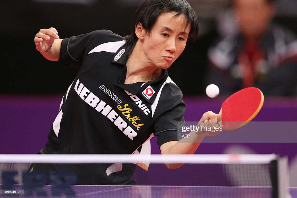 Austria's Jia Liu plays against North Korea's Myong Sun Ri on May 17, 2013 in Paris, during the fourth round of Women's Singles of the World Table Tennis Championships. AFP PHOTO / THOMAS SAMSON
