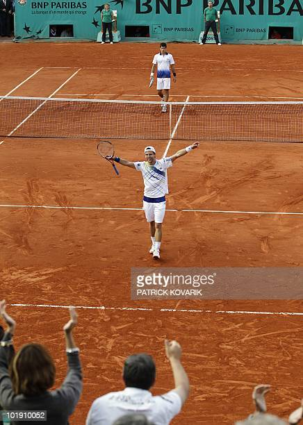 Austria's Jurgen Melzer celebrates after beating Serbia's Novak Djokovic following their quarterfinal match in the French Open tennis championship at...