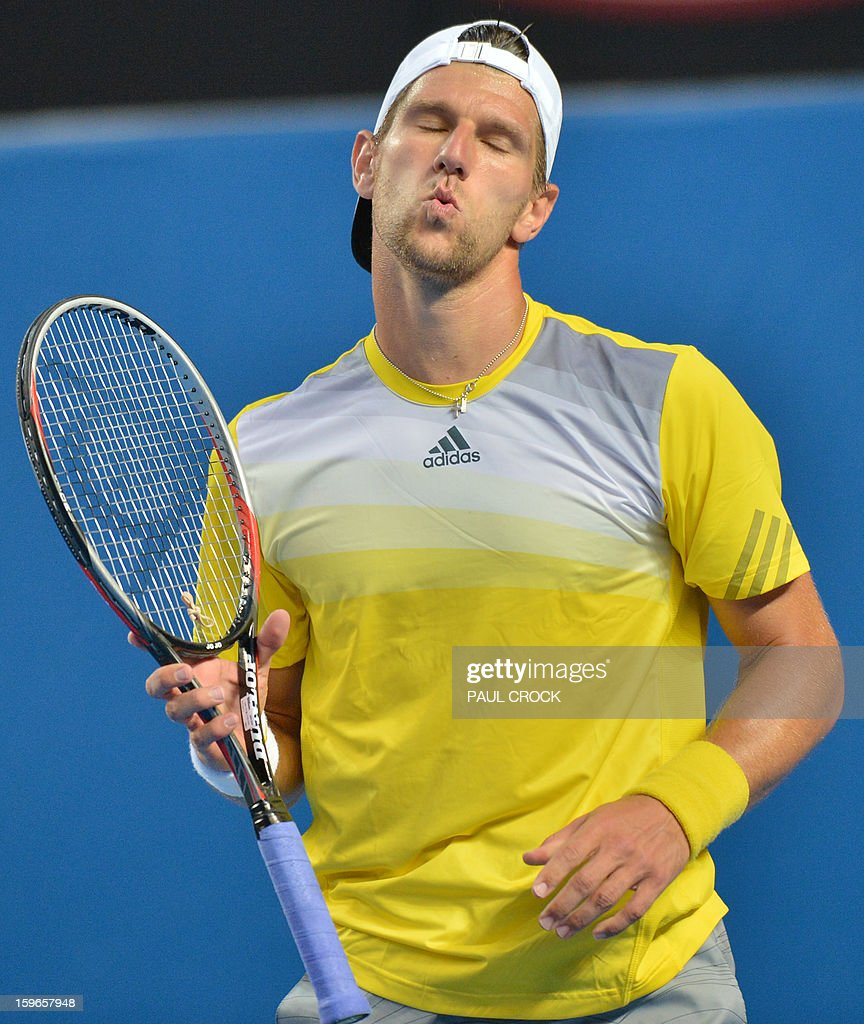 Austria's Jurgen Melzer gestures during his men's singles match against Czech Republic's Tomas Berdych on the fifth day of the Australian Open tennis tournament in Melbourne on January 18, 2013. AFP PHOTO/PAUL CROCK IMAGE STRICTLY RESTRICTED TO EDITORIAL USE - STRICTLY NO COMMERCIAL USE