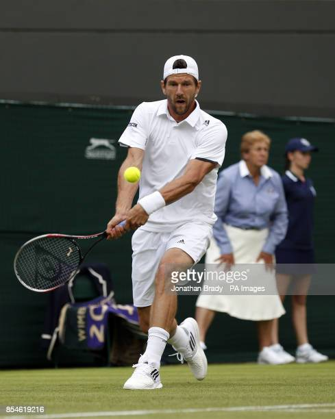 Austria's Jurgen Melzer in action against France's JoWilfried Tsonga during day one of the Wimbledon Championships at the All England Lawn Tennis and...