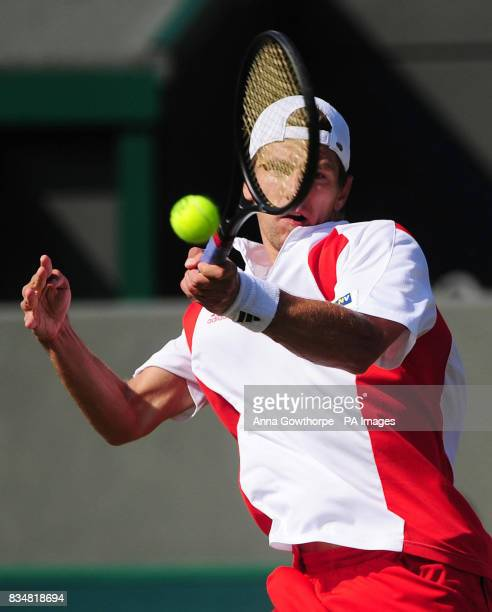 Austria's Jurgen Melzer in action against Great Britain's Andy Murray during the Davis Cup World Group PlayOffs at The All England Lawn Tennis Club...