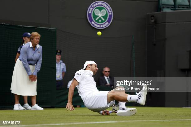 Austria's Jurgen Melzer is beaten by a shot and ends up on the floor during his match against France's JoWilfried Tsonga during day one of the...