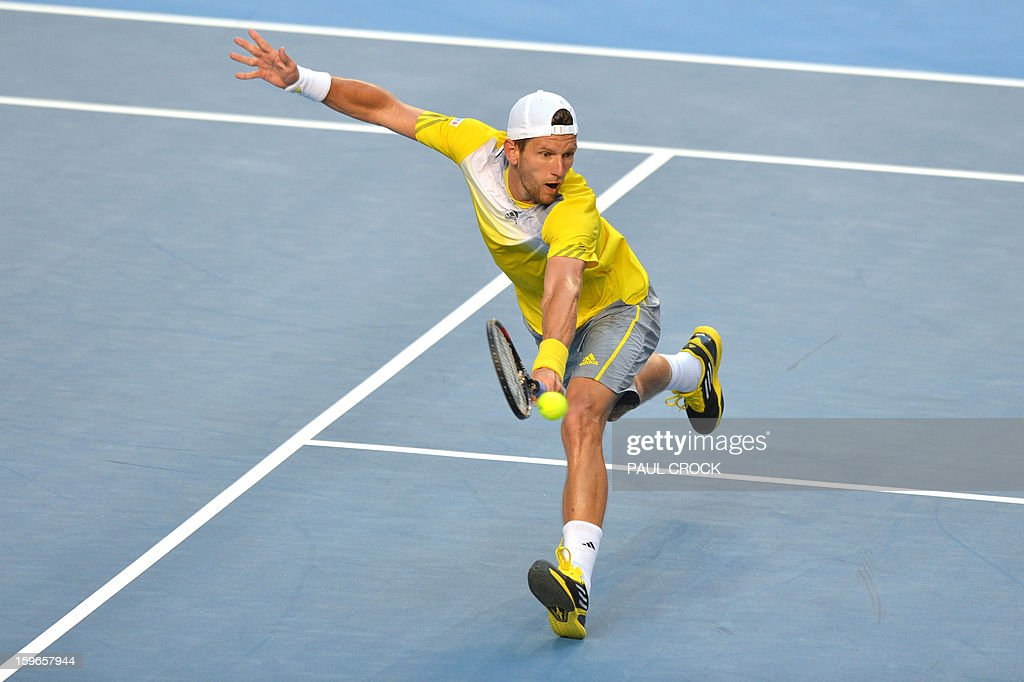 Austria's Jurgen Melzer plays a return during his men's singles match against Czech Republic's Tomas Berdych on the fifth day of the Australian Open tennis tournament in Melbourne on January 18, 2013.