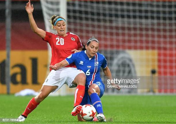 Austria's Lisa Makas challenges Iceland's Holmfridur Magnusdottir during the UEFA Women's Euro 2017 football match between Iceland and Austria at the...