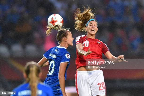 Austria's Lisa Makas heads the ball with Iceland's Dagny Brynjarsdottir during the UEFA Women's Euro 2017 football match between Iceland and Austria...