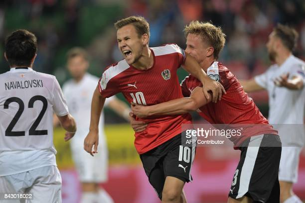 Austria's Louis Schaub celebrates scoring an equalizer making it 11 during the Group D FIFA World Cup 2018 qualification match between Austria and...