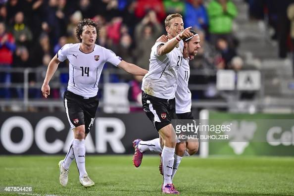 Austria's Marc Janko celebrates with teammates Martin Harnik and Julian Baumgartlinger after scoring the second goal of the match during the Euro...
