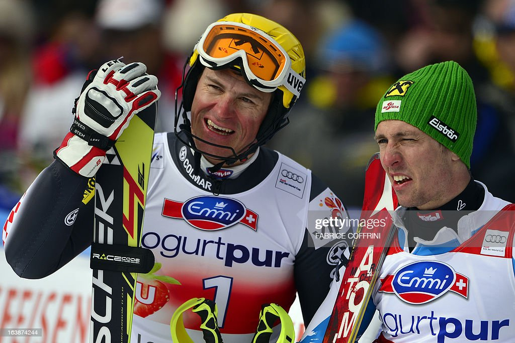 Austria's Marcel HIrscher (R) and Croatia's Ivica Kostelic stand in the finish area on March 17, 2013 after the men's slalom race of the Alpine ski World Cup finals in Lenzerheide.