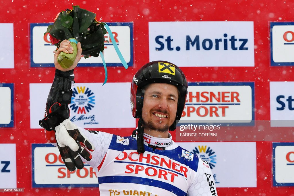 Austria's Marcel Hirscher celebrates during the flower ceremony after winning the men's giant slalom race at the 2017 FIS Alpine World Ski Championships in St Moritz on February 17, 2017. / AFP / Fabrice COFFRINI