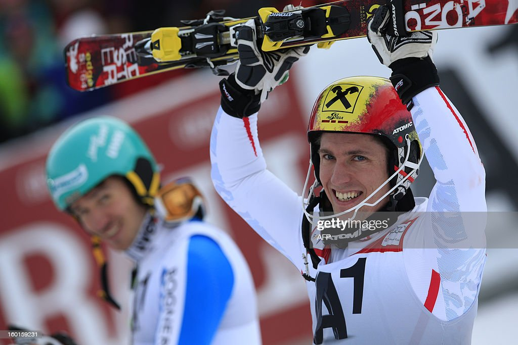 Austria's Marcel Hirscher (R) celebrates next to Germany's Felix Neureuther (L) after competing at the second run of the FIS World Cup men's slalom race on January 27, 2013 in Kitzbuehel, Austrian Alps. Austrian Marcel Hirscher won the race, German Felix Neureuther placed second and Croatian Ivica Kostelic placed third.