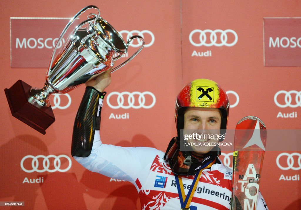 Austria's Marcel Hirscher celebrates on the podium after the FIS Ski World Cup Parallel Slalom city event in Moscow on January 29, 2013. Marcel Hirscher won the competition.