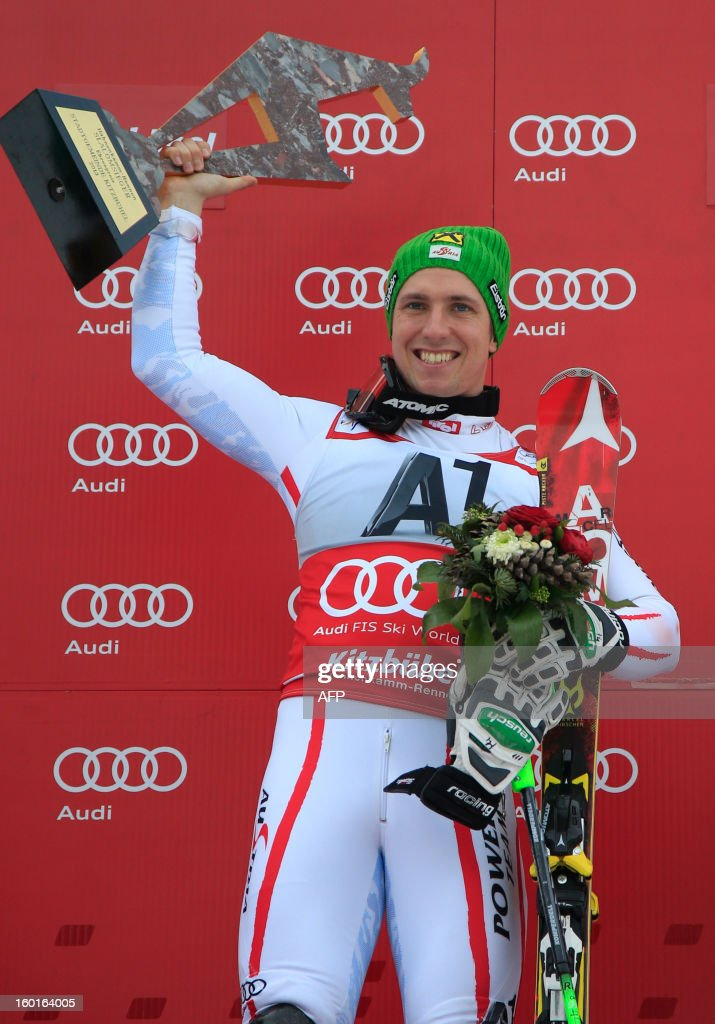 Austria's Marcel Hirscher celebrates on the podium after winning at the FIS World Cup men's slalom race on January 27, 2013 in Kitzbuehel, Austrian Alps. Marcel Hirscher placed first, German Felix Neureuther placed second and Croatian Ivica Kostelic placed third.